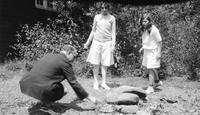 Elizabeth (Biz) Schoonover as a child outdoors with two unidentified companions