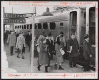 Commuters boarding new Silverliner at Levittown Station on the PRR's Ternton-Levittown line